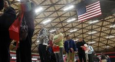 In this April 10, 2012, file photo, people wait in a line at a job fair in Gresham, Ore. - (AP Photo/Rick Bowmer, file