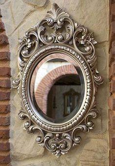 Espejo con marco ovalado decorado con volutas en color plateado.  Medidas:  Ext. 61 x 37,5 cm  Int. 27,5 x 22,5 cm - Fabricado y decorado artesanalmente con un material innovador resistente y ligero como es la resina de poliuretano. Tiene un tacto semejante a la madera pero sin sus inconvenientes. Precio: 54 euros #decoracion con encanto #Espejos