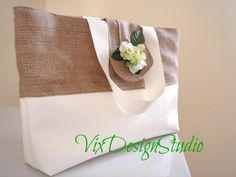 Big burlap tote bag with eco-leather and flowers Beach bag Diaper bag Bridesmaid rustic gift Shabby chic Romantic Monogrammed bag. $75.00, via Etsy.