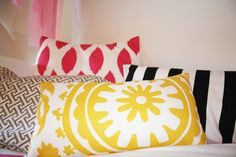 Love the color and pattern mix on these #pillows  #toddlerroom #yellow #hotpink