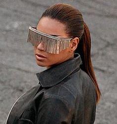 Kim Kardashian was spotted wearing a pair of gold aviator fringe sunglasses. Hmmm...trendy?