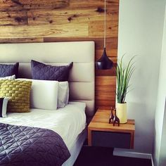 Master bedroom with feature timber wall and custom bedheadswest elm duvet