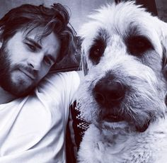 Liam Hemsworth - This adorable Labradoodle was rescued by Liam and Miley Cyrus, from Wylder's Holistic Pet Center in Los Angeles. The couple has many other rescue dogs as well. Hemsworth Brothers, Liam Hemsworth, Love Your Pet Day, Celebrity Dogs, Thug Life, Dog Photos, Four Legged, Mans Best Friend, Hottest Photos