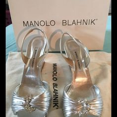 Sale! Auth Manolo Blahnik Silver D'Orsay  Wedge 39 Very good condition barely worn (less than 5 times) Manolo Blahnik D'orsay Gramsling Nappa Lamb Silver Slingback Wedge Eu size 39.  I've worn these a handful of times in the last 4 years.  Sad to let them go but it's a different life and a different shoe size after pregnancy.  I always use petal pusher cushions in my shoes so there is a small worn patch on the ball of the foot in left foot sole.  Comes with duster bag and original box…