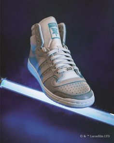 These Adidas x Star Wars Sneakers Are Inspired by Lightsabers - Star Wars Shoes - Ideas of Star Wars Shoes #starwars #shoes #starwarsshoes - Adidas Originals Top Ten Hi adidas x star wars obi-wan kenobi sneakers Star Wars Film, Star Wars Darth, Camisa Star Wars, Adidas Originals Tops, Star Wars Shoes, Adidas Dame, Sneaker Release, Star Wars Gifts, Star Wars Tshirt