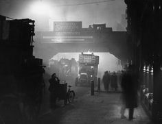1 November 1922: Fog encases workers at Ludgate Circus, London. It was reported that Londoners compared the effects of winter fogs to being blind as they could often only see a few yards ahead.