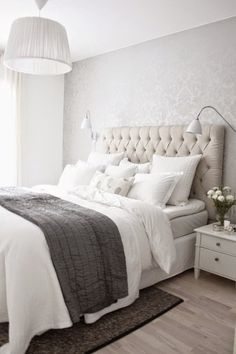 The wall paper and overhead light finishes this room off nicely. Beautiful mix of whites, creams and browns.