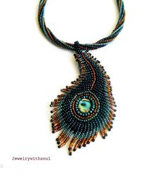 Peacock's feather bead embroidery pendant necklace with paua abalone cabochons, twisted beaded rope and fringe in blue green teal and copper. $72.00, via Etsy.