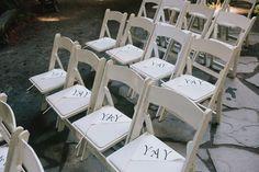 """YAY"" flags at each ceremony seat, photo by @Doriana Westerman /Sun + Life Photography http://ruffledblog.com/california-redwoods-wedding #ceremony #papergoods #wedding"
