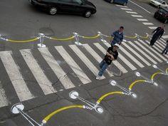 To encourage the city of Montreal to build more bike lanes, street artist Peter Gibson aka 'Roadsworth' started a guerrilla street art. Street Marketing, Guerilla Marketing, Viral Marketing, Passage Piéton, Pedestrian Crossing, Road Markings, Street Art Utopia, Zebra Crossing, Canadian Artists