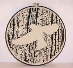 Gorgeous silhouette embroidery of birches and a blackbird - I love art that works heavily with negative space