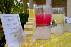 """""""We got married on the HOTTEST day of the year. No lie. I planned to have a lemonade stand to help my guests cool off. I designed the sign in Word, printed it and framed it. The drink urns were from Walmart, and the table cloth was bought on clearance at Target."""""""