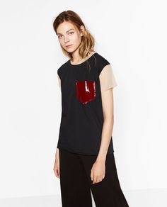 Image 5 of T-SHIRT WITH PATENT FINISH POCKET from Zara