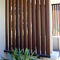 Motorised vertical timber louvres