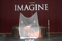 Imagine No Malaria themed stage décor at the Stuart Auditorium in Lake Junaluska was part of Holston Annual Conference's Imagine No Malaria worship service