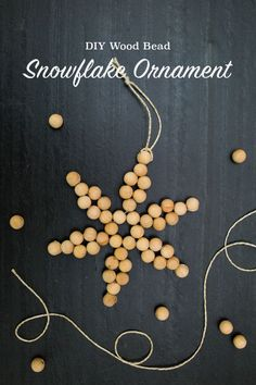 DIY Wood Bead Snowflake Ornaments — tinsel + trim MATERIALS AND SUPPLIES 24 gauge jewelry wire 12 mm natural wood beads makes one ornament) Ribbon or string for loop Wire cutters Round nose pliers (optional) Scandinavian Christmas Ornaments, Scandinavian Holidays, Wooden Christmas Decorations, Beaded Christmas Ornaments, Snowflake Ornaments, Snowflakes, Christmas Crafts, Beaded Snowflake, White Christmas