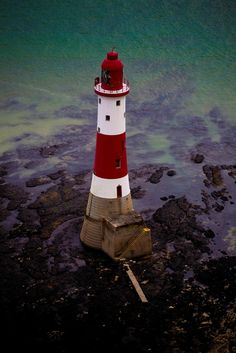 Beachy Head Lighthouse The 43m red and white striped tower, 500ft below the summit of the dramatic chalk cliffs near Eastbourne, East Sussex, is at risk following a review by Trinity House, which in charge of navigational aids around the UK coastline.