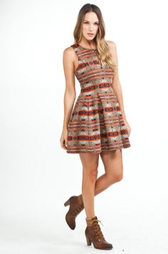 PENDLETON x Opening Ceremony  Voluminous Keyhole Dress in Tan        Self: 100% wool      Lining: 100% rayon      Made in USA      Fully lined      Button closure at neckline      Keyhole detail on front      Side slit pockets      Hidden side zip closure      Flounce bottom      See fit guide for measurements      Our Style # PENX-WD1      Designer Style # PWD04-FW11      Special order this item.    $605