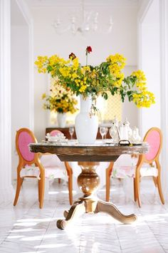 <3 Love the Tall vase and large yellow branches! and the pink chairs