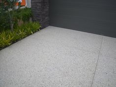 Like this look for the driveway. Exposed aggregate cement driveway