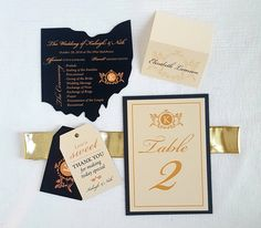 Ohio cutout wedding program with matching table number, favor tags and escort card. Black with gold wedding detail ideas