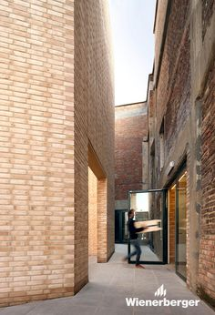 Former textile factory in Kortrijk, Belgium, converted into the Buda Art Centre with a five-side brick entrance pavilion by Brick Architecture, Contemporary Architecture, Architecture Details, Interior Architecture, Brick Construction, Open Trap, Mother Art, Brick Texture, Art Deco
