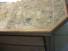 Kitchen Countertop With Wood Trim Rd Close Up Of Marble Tile