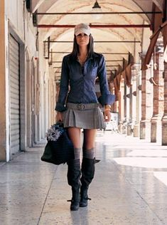 skirt is out of date never wear a duckbill hat with anything like this boots are the wost choice you could make!!!