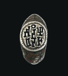 A SOUTH ARABIAN SILVER RING   CIRCA 3RD CENTURY A.D.   The hoop with angled shoulders and incised foliate decoration, the bezel with Old South Arabian three column inscription giving the name of the owner as 'Ammi-anan Had(du)'  Bezel 5/8 in.(1.6 cm.) wide; ring size I½