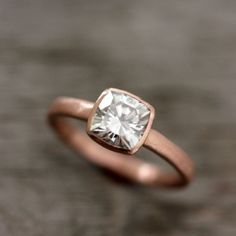 Rose Gold Engagement Rings, maybe with matching diamond wedding band with little square or round diamonds.  Not sure if I like the flat rose gold or polished.