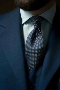 Blue suit, dotted tie. Mind the details.