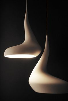'Dollop' lamp by Ash Allen; inspired from a dollop of cream on a spoon. The light source cannot be seen round the bend of the lamp.