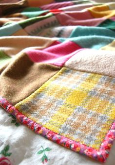 more wool/sweater squares, this one with no back, just a calico bound edge.