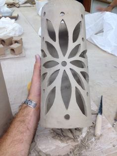 Another Ceramic lantern I made. Slab rolled over a plastic tube, removed the tube, waited till leather hard and carved