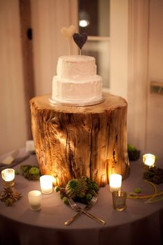 huge wooden cake stand. love the size of cake for  bride/groom cake cutting, then cupcakes for everyone else :)