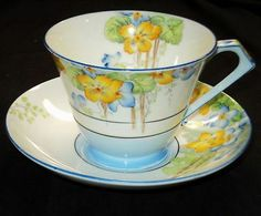 ROYAL PARAGON BLUE WHITE YELLOW ART DECO TEA CUP AND SAUCER