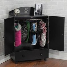 Dog Armoire with hanging bar for apparel and a drawer for shoes, collars, leashes and other accessories.