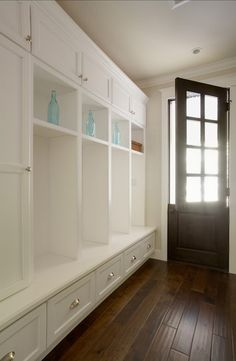 Mud room with white lockers and built in storage