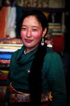 Zhaxi Zhuoma, a Tibetan shepherdess, has red cheeks and cloudy pupils due to damage from the ultraviolet light in the Qinghai-Tibet Plateau. Yet, her natural beauty is not impaired at all. - See more at: http://www.visiontimes.com/2013/09/21/travel-china-photo-report-the-power-of-tibetan-plateau.html