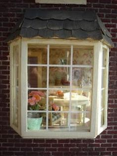 Bay window white trim carron 39 s house exterior for What to put in front of a bay window