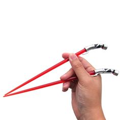 The Force is strong in these chopsticks. A seamless replica of Sith Lord Count Dooku's uniquely-shaped red lightsaber is now in the form of functional chopsticks. Service for: One (1) Number of pieces