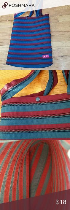 ZIP IT bag Cute and fun bag made of zippers.  The colors are a nice blend of maroon and teal.  The  bag measures 15 by 17 inches.  In excellent condition. Zip It Bags