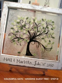 DIY wedding guest tree + old window frame...she made the tree, then guests wrote in their names on the leaves.