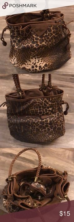 Animal print bag Used a lot but still looks great , has some peeling on last picture Jessica Simpson Bags
