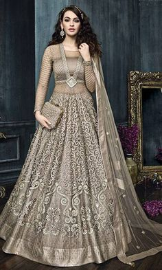 Indian designer wear ..Bridal collection ..Beige Heavy Embroidered Anarkali Suit.Contact Anjali designer wear @9179504192