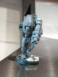 """Conversion from https://www.facebook.com/minimoped/ Features Tau Stealth suit head, greyknight psicannon, tau broadside """"assthing"""" for the back with a Tau plasma rifle exhaust, skull and necron legs."""