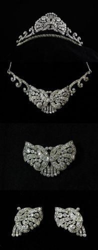 A 1930's parure which assembles into the tiara pictured or similar necklace. Comprises a pair of dress clips with brooch fitting, which combine to form the center butterfly style motif, and the two scrolling sides (necklace or tiara) total weight excess of 10 carats