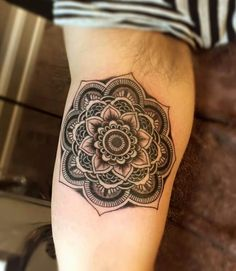 Mandala arm tattoo