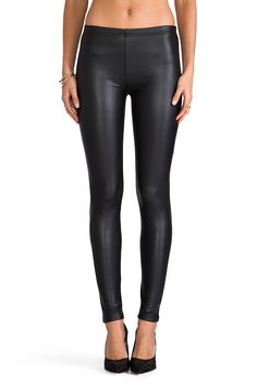 Faux leather leggings are the best for travel! You can look much more dressed up while staying comfortable. Plus, they are so lightweight and take up much less space than any kind of denim, especially real leather. #lightpacking #REVOLVEclothing