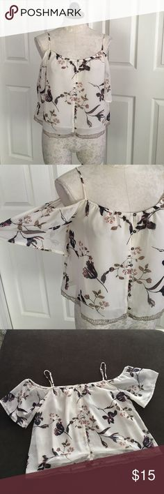 """Astr The Label Cold Shoulder Floral Top New with tag. Astr floral print cold shoulder top size xs. Has button front but can be put on over head easily. Very lovely trim at the bottom edge, has a slip lining. 100% Polyester, adjustable straps. Front length is 14"""", across bust 18.5"""", loose silhouette. Astr The Label Tops Crop Tops"""
